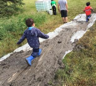 Running down the mud slide.