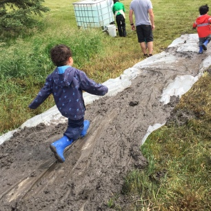 Running down the mud slide.